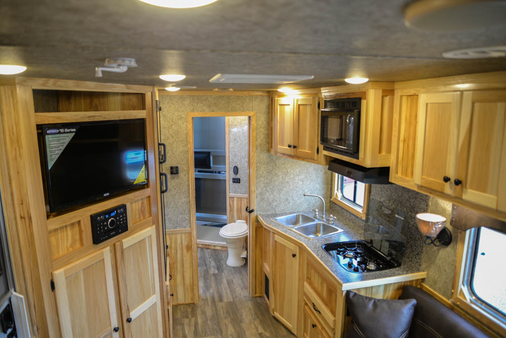 Living space in a Charger C8X13.6 | Lakota Trailers