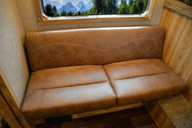 Sofa in LEX9 Charger Edition Livestock Trailer | Lakota Trailers