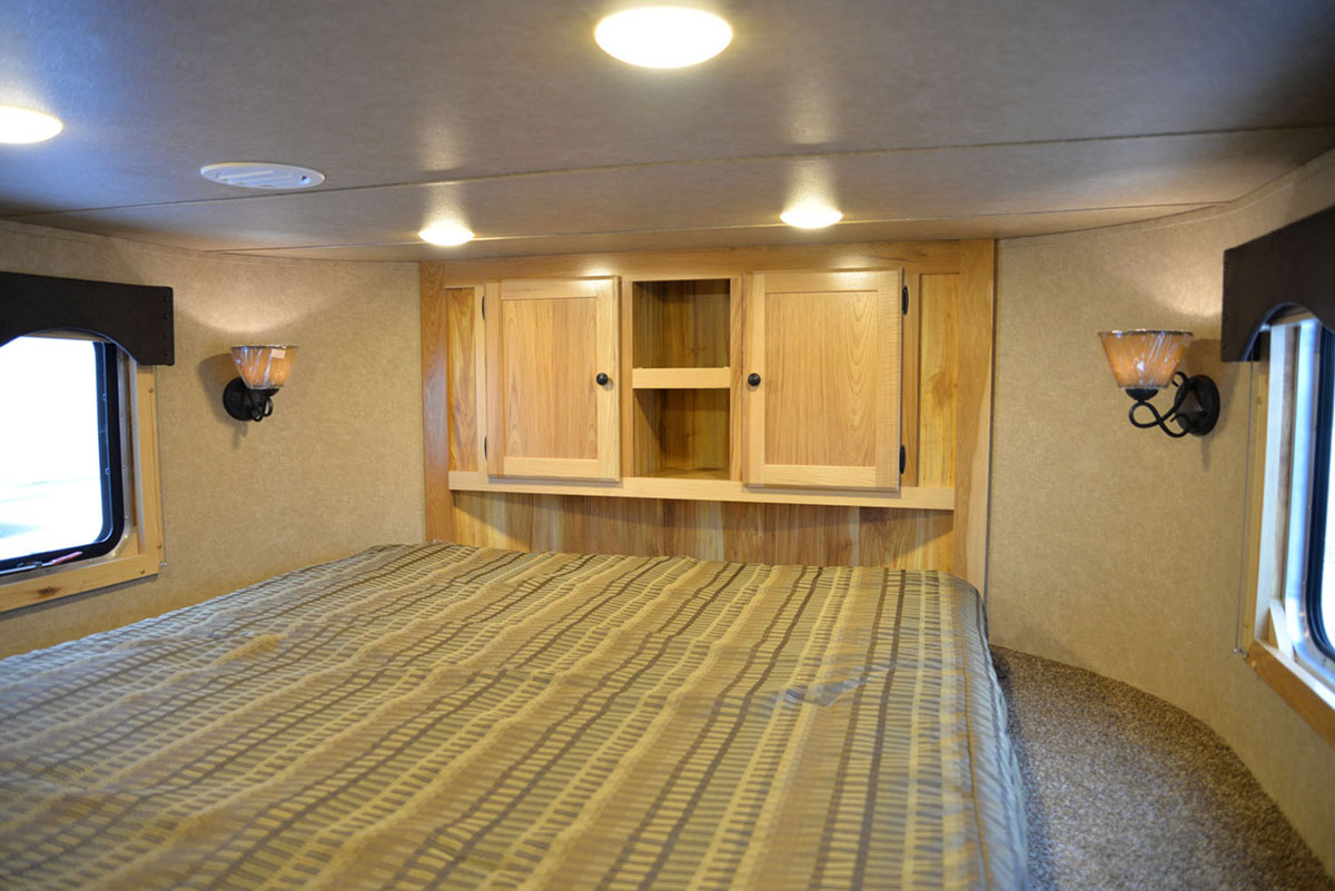 Bedroom in LE8X14CE Charger Livestock | Lakota Trailers