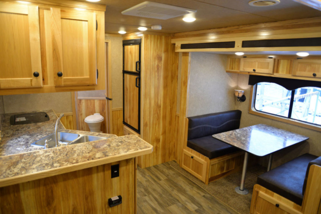 Living space in LE8X14CE Charger Livestock | Lakota Trailers