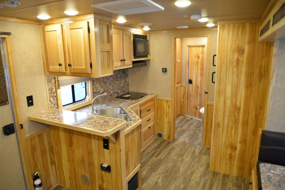 Living space in LE8X14CE Charger Livestock   Lakota Trailers
