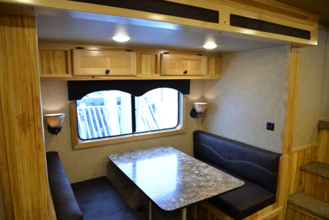 Dinette in slide out in LE8X14CE Charger Livestock | Lakota Trailers