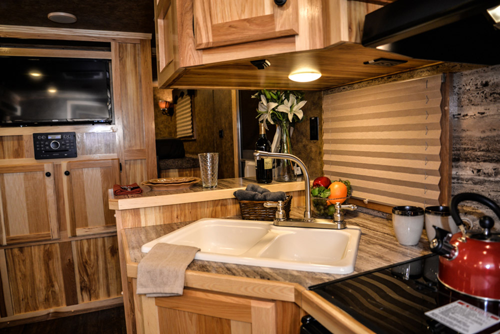 TV Living space in a Charger C8X13RK   Lakota Trailers