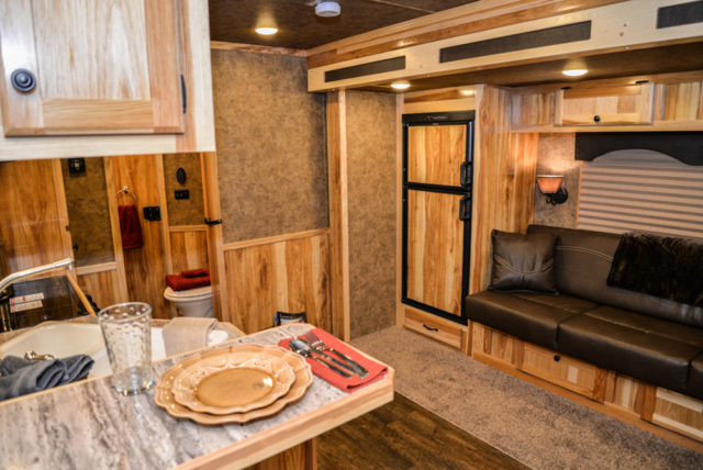 Living space in a Charger C8X13RK   Lakota Trailers