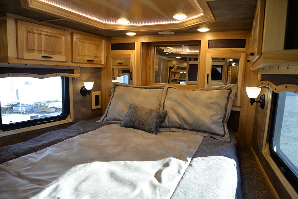 Bedroom in a Bighorn Livestock BLE8X18CE | Lakota Trailers
