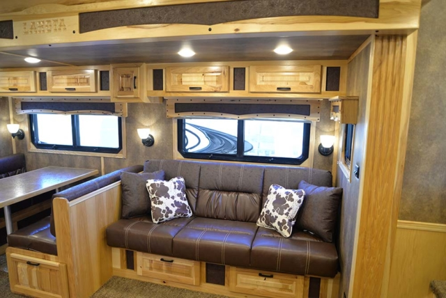 Couch and Dinette in Bighorn BLE8X18CE Livestock Trailer | Lakota Trailers