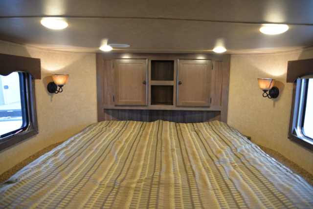 Bedroom in a Charger Livestock C8X11RK | Lakota Trailers