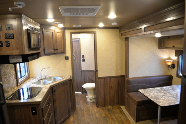 Living space in a Charger Livestock C8X11RK | Lakota Trailers