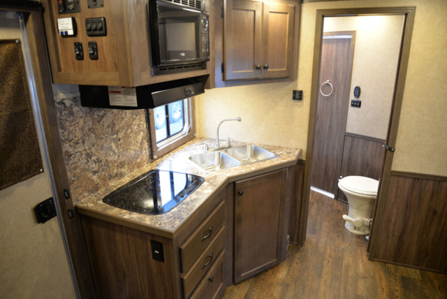 Kitchen in a Charger Livestock C8X11RK | Lakota Trailers
