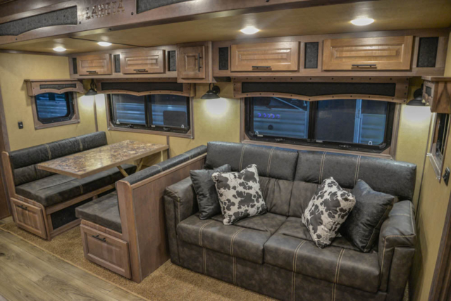 Sofa and Dinette in Slide-out in BH8X18MB Bighorn Edition Horse Trailer | Lakota Trailers