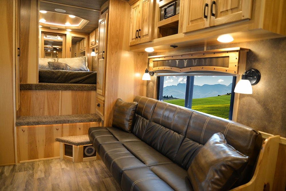 Sofa in a BH8X15TDSRK Bighorn Edition Horse Trailer   Lakota Trailers
