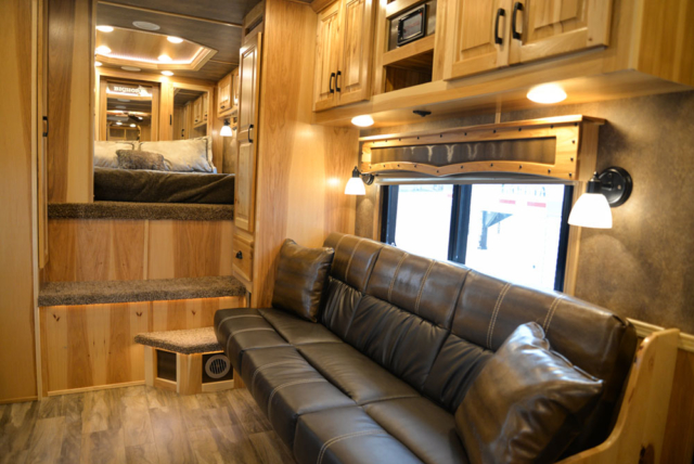 Sofa in a BH8X15TDSRK Bighorn Horse Trailer | Lakota Trailers