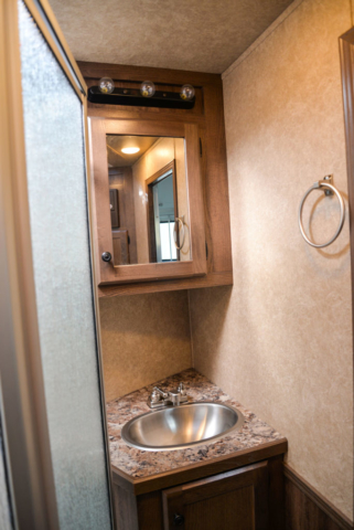 Bathroom in a C8X7 Charger Edition Horse Trailer| Lakota Trailers