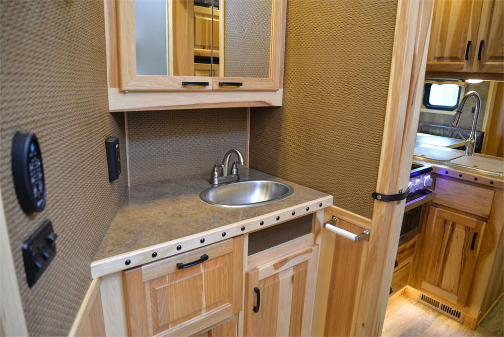 Bathroom in a BH8X15TDSRK Bighorn Horse Trailer | Lakota Trailers
