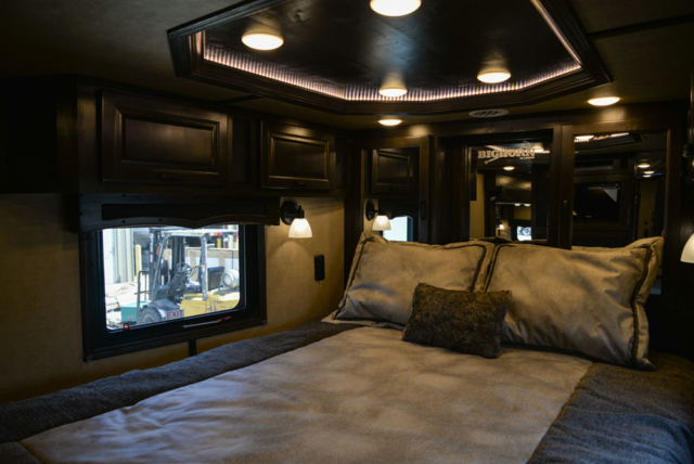 Bedroom in a 2020 BH8X18TCE Bighorn Horse Trailer | Lakota Trailers