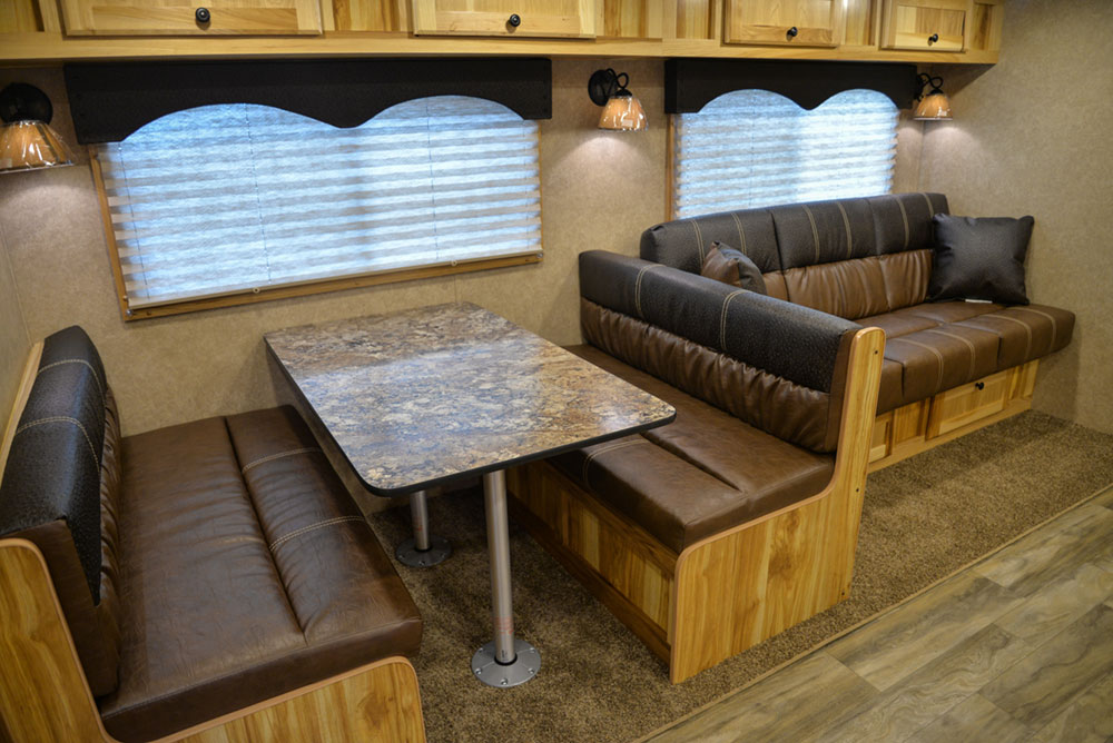 Dinette and Sofa in a C8X17EH Charger Edition Horse Trailer| Lakota Trailers