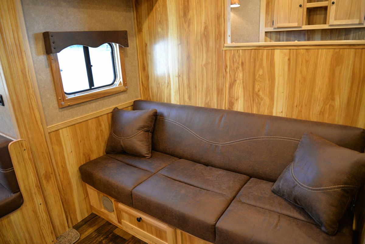 Sofa in a LE8X15 - Charger Livestock Edition Trailer| Lakota Trailers