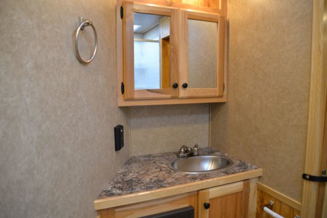 Bathroom in a LE8X15 - Charger Livestock Edition Trailer| Lakota Trailers