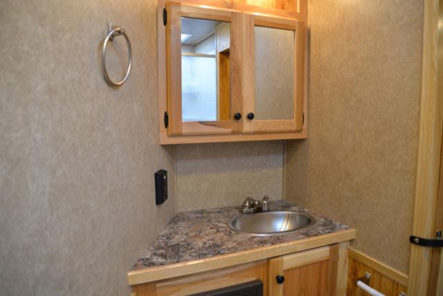 Bathroom in a LE8X15 - Charger Livestock Edition Trailer  Lakota Trailers