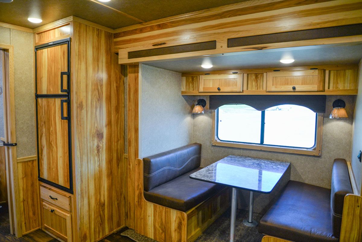 Dinette in a LE8X15 - Charger Livestock Edition Trailer| Lakota Trailers