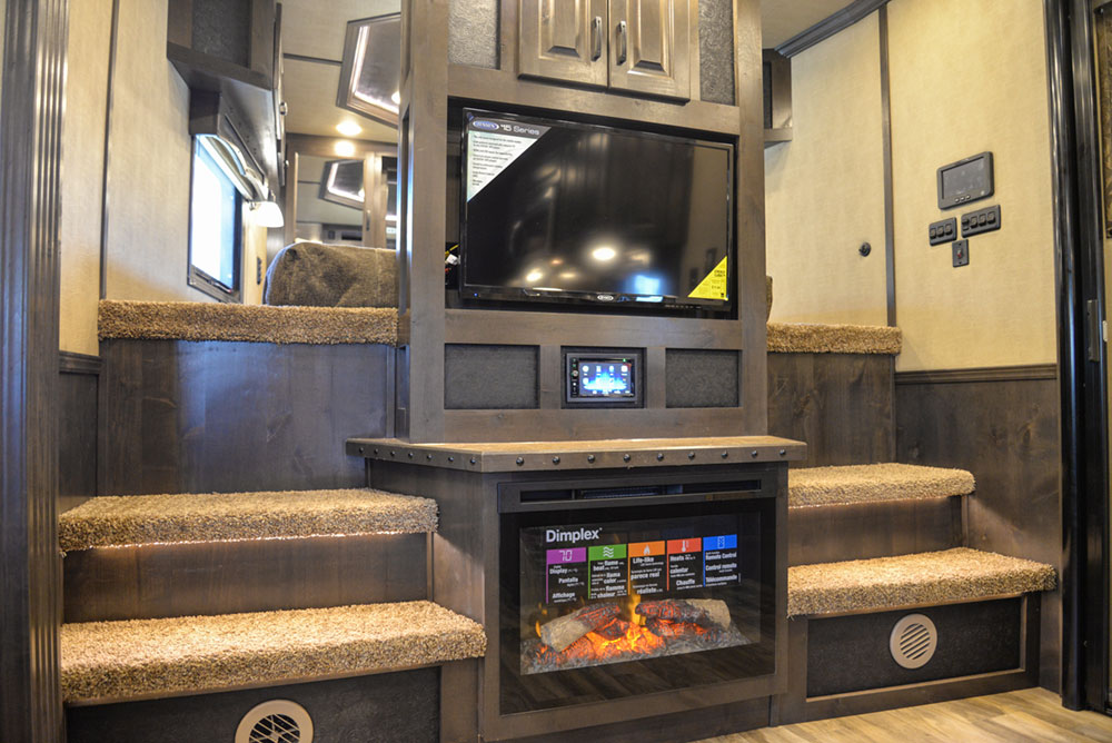 Entertainment System and Fireplace in a 2020 BH8X18TCE Bighorn Horse Trailer   Lakota Trailers
