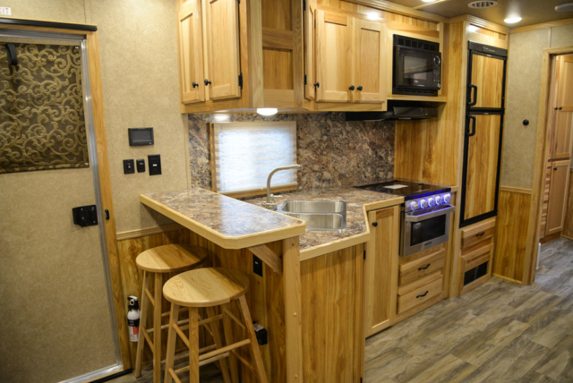 Kitchen and Bar in a C8X17EH Charger Edition Horse Trailer| Lakota Trailers