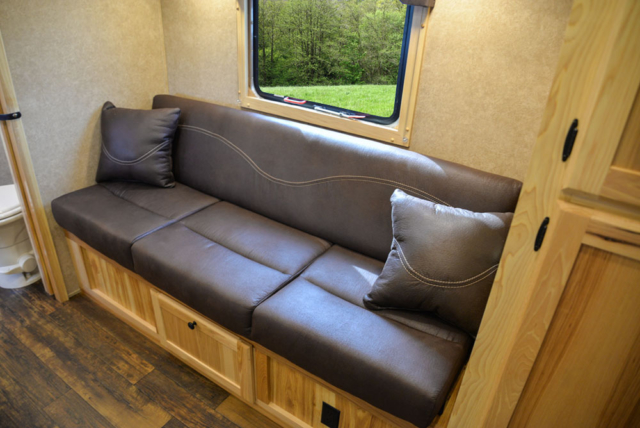 Sofa in a Charger Bumper Pull C8XHSLBP12SE | Lakota Trailers