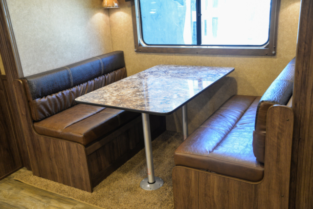Dinette in a Charger C8X15SRB Horse Trailer | Lakota Trailers