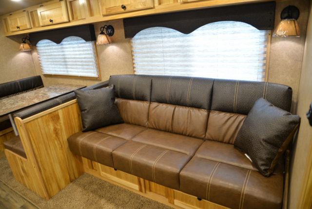 Sofa in a C8X17EH Charger Edition Horse Trailer| Lakota Trailers