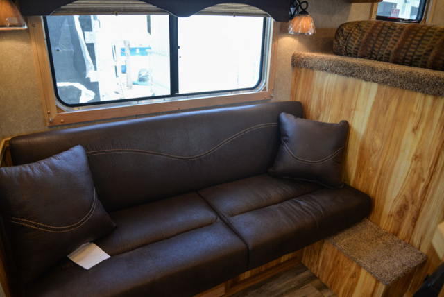 Sofa in a CX7 Charger Edition Horse Trailer | Lakota Trailers