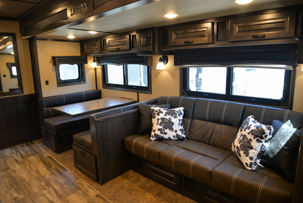 Sofa and Dinette in a 2020 BH8X18TCE Bighorn Horse Trailer   Lakota Trailers