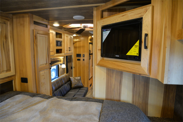 Bedroom Entertainment System in a BH8X15TDSRK Bighorn Horse Trailer | Lakota Trailers