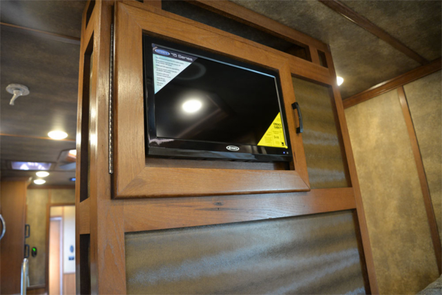 Bedroom TV in a BLE8X15CE Bighorn Edition Livestock Trailer| Lakota Trailers