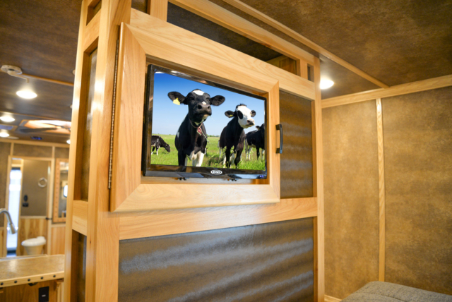 Bedroom TV in a BLE8X18CE Bighorn Edition Livestock Trailer | Lakota Trailers
