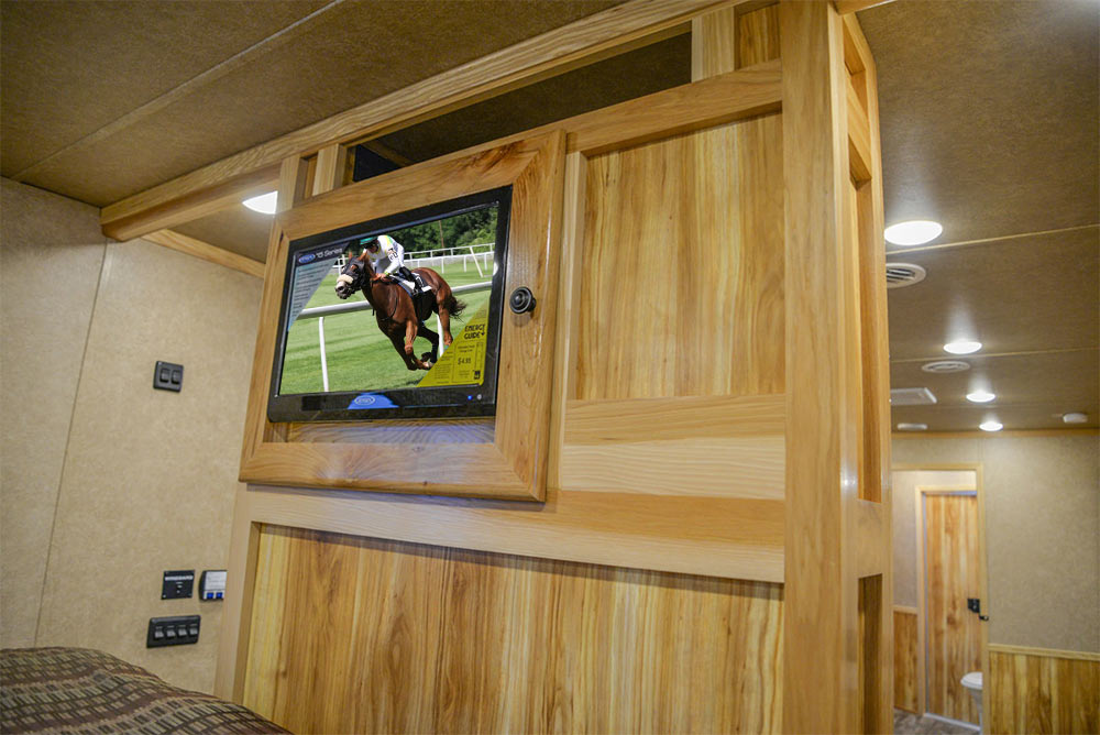 TV in Gooseneck in C8X18CE Charger Edition Horse Trailer | Lakota Trailers
