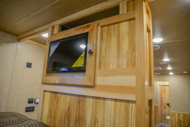 Bedroom TV in Charger C8X18CE Horse Trailer | Lakota Trailers