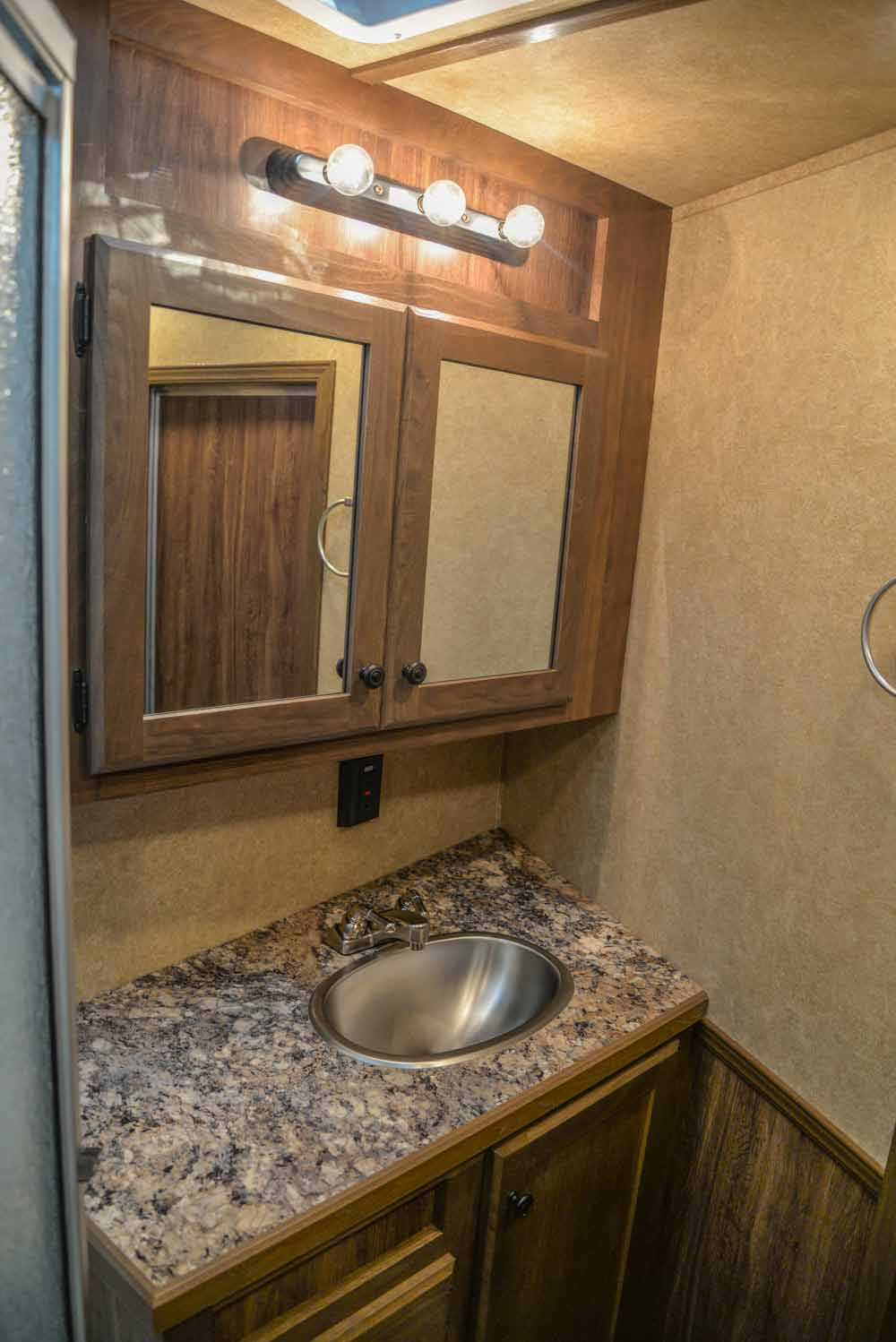 Bathroom in a LE8X16BB Charger Edition Livestock Trailer | Lakota Trailers