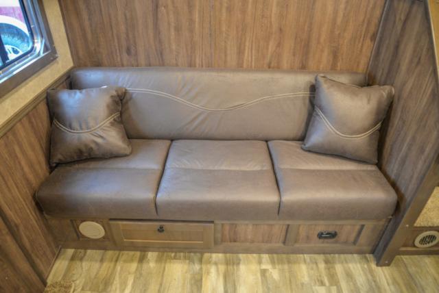 Sofa on Riser in C8X13SR | Lakota Trailers