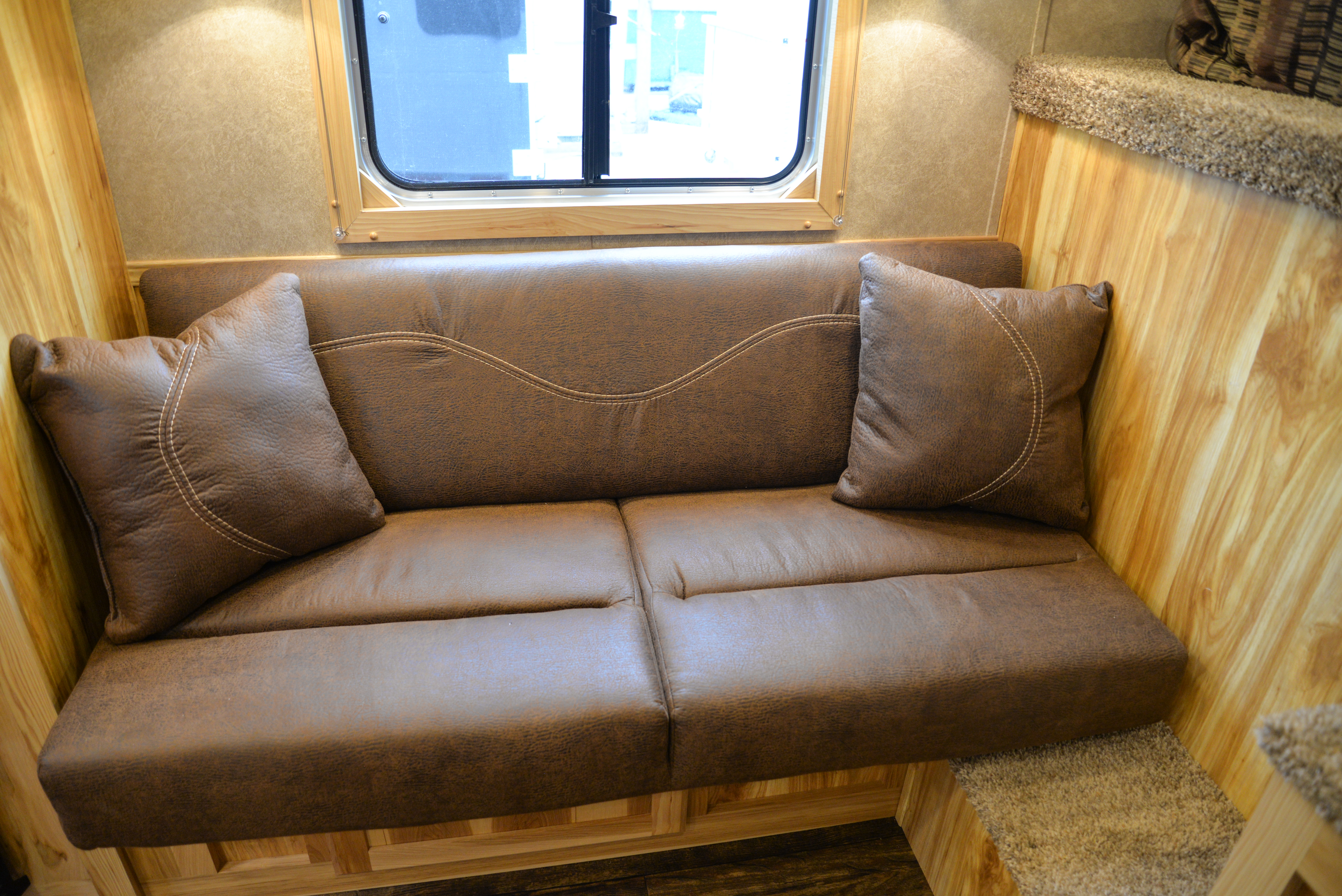 Sofa in a CX9 Charger Edition Horse Trailer | Lakota Trailers