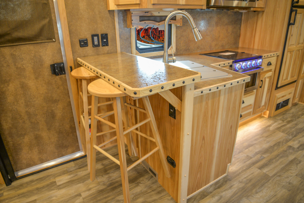Hanging Barstools in a BLE8X18CE Bighorn Edition Livestock Trailer | Lakota Trailers