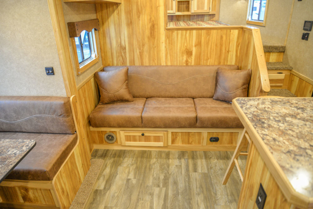 Sofa on Riser Wall in C8X15SRB9S Horse Trailer | Lakota Trailers