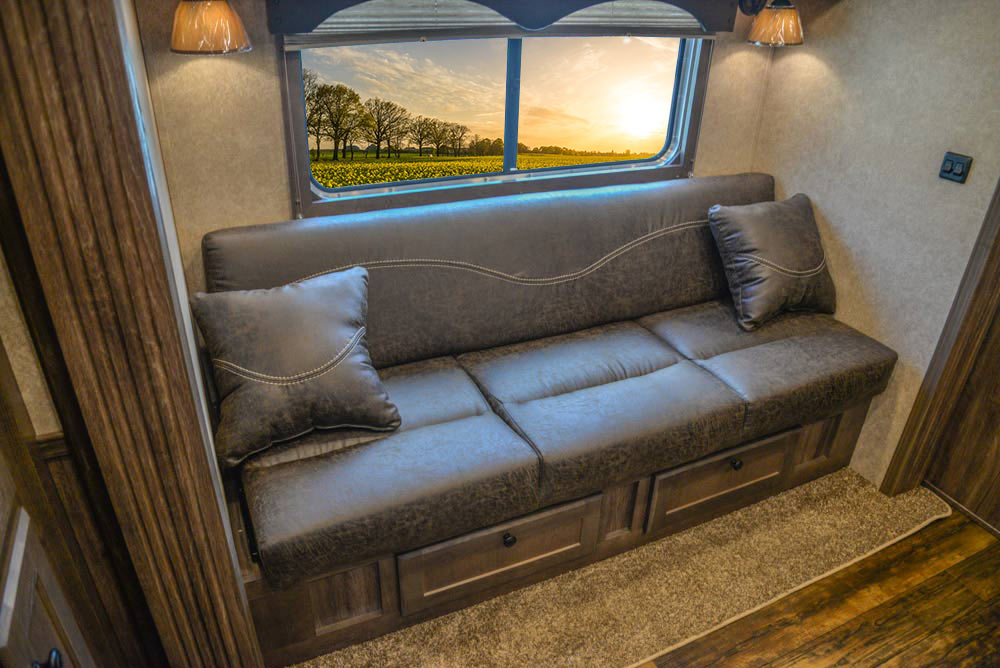Sofa in Slide-Out in CX11 Charger Edition Horse Trailer   Lakota Trailers