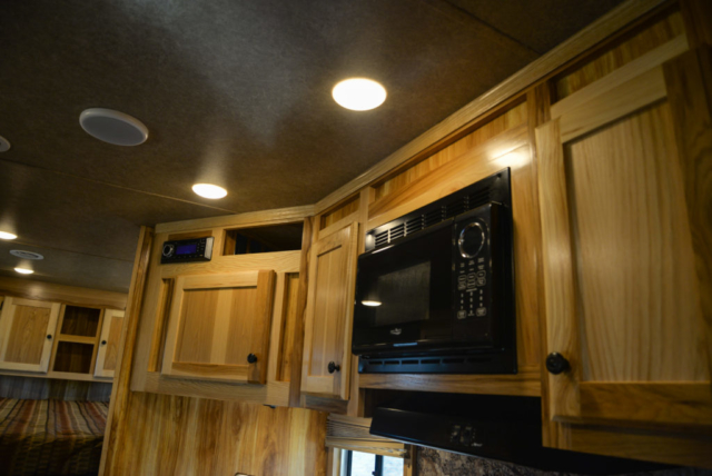Microwave and Cabinets in a Charger C8X16BB Horse Trailer | Lakota Trailers