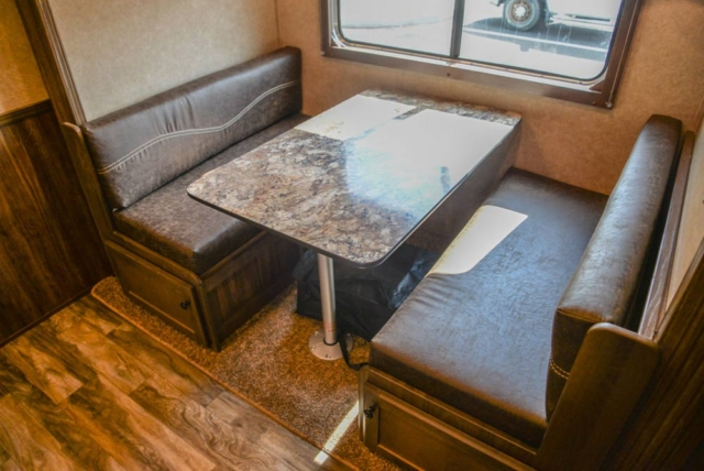 Dinette in a LE8X16BB Charger Edition Livestock Trailer | Lakota Trailers