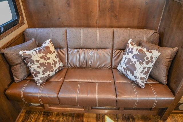 Sofa in a BH8X13SR Bighorn Edition Horse Trailer | Lakota Trailers