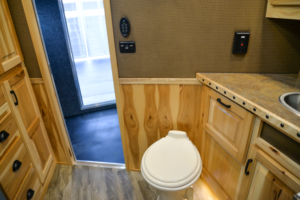 Bathroom in a BLE8X18CE Bighorn Edition Livestock Trailer | Lakota Trailers