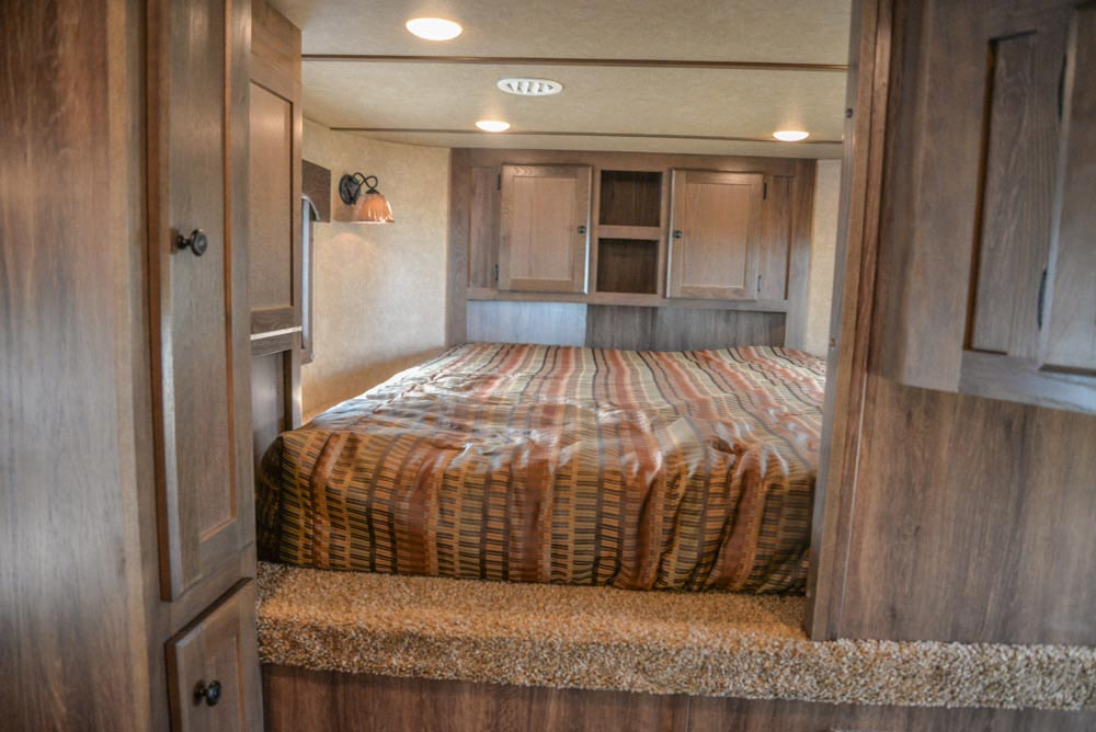 Bed in Gooseneck in a LE8X16BB Charger Edition Livestock Trailer | Lakota Trailers