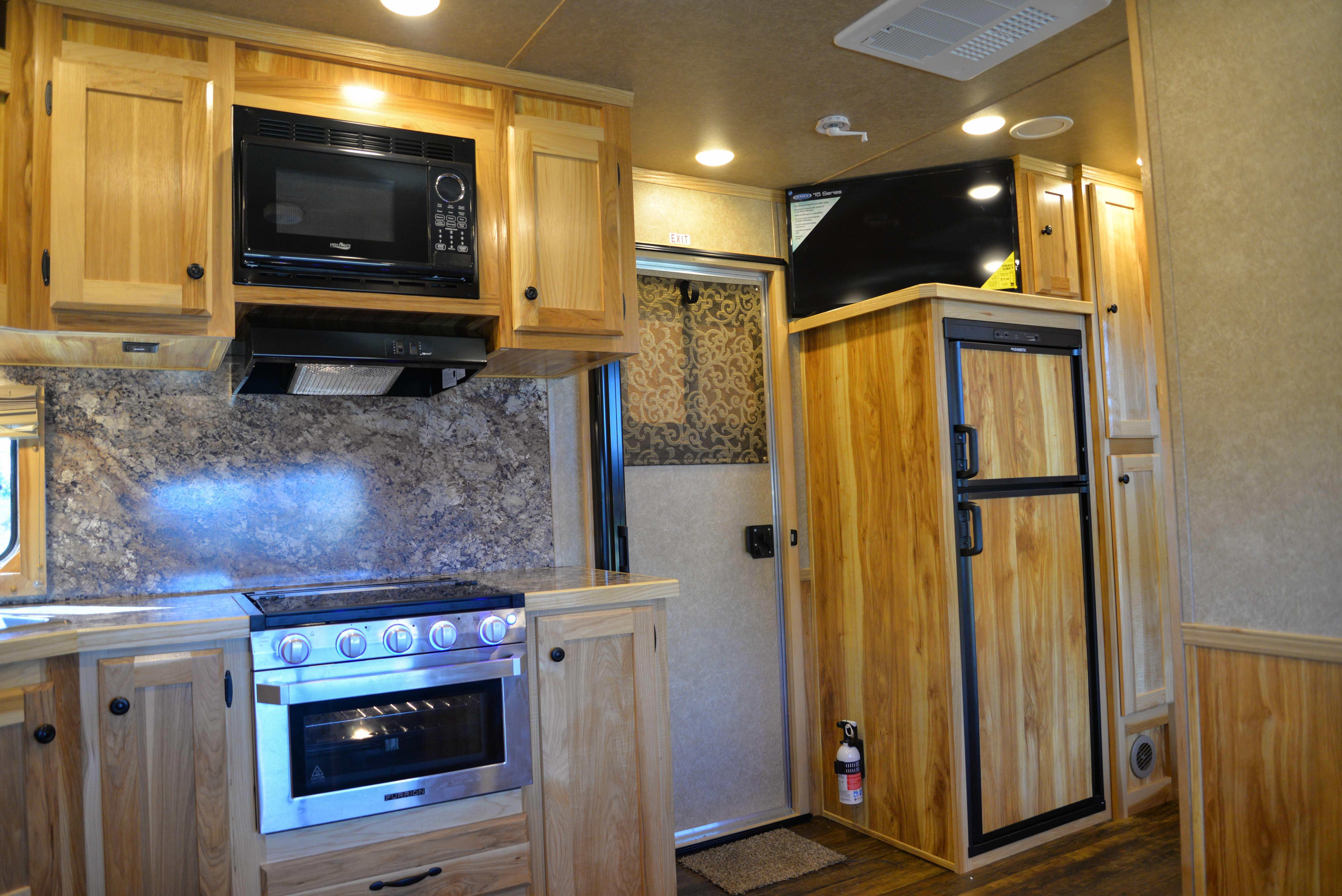Entertainment System, Refrigerator, and Stove Top in a Charger C8X16BB Horse Trailer | Lakota Trailers