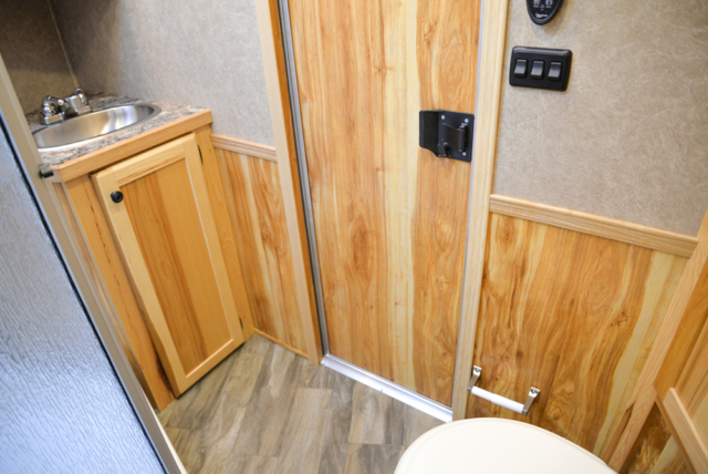 Bathroom in a C8X15RKB Charger Edition Horse Trailer | Lakota Trailers