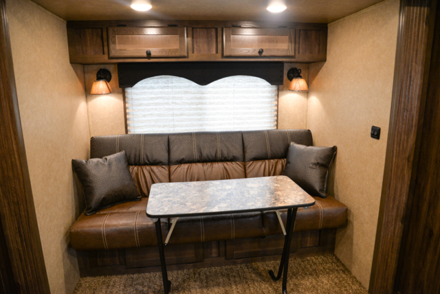 Sofa and Table in a C8X11 Charger Edition Horse Trailer | Lakota Trailers